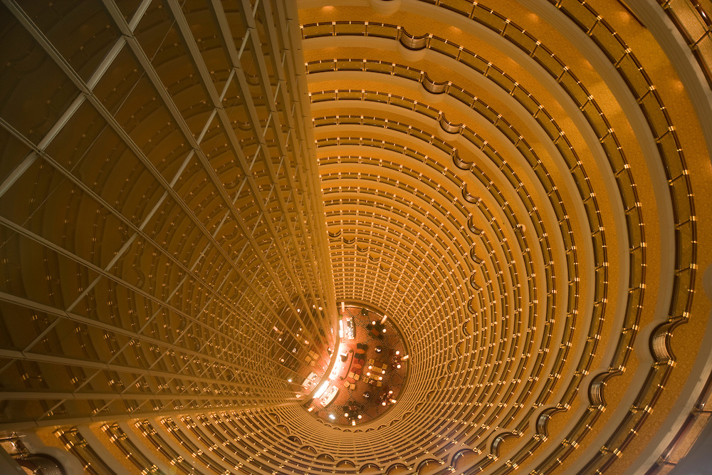 Asia, China, Shanghai, Overhead view looking down into 152-foot atrium of Grand Hyatt Shanghai Hotel inside 88-story Jin Mao Tower in Pudong New Economic Zone.