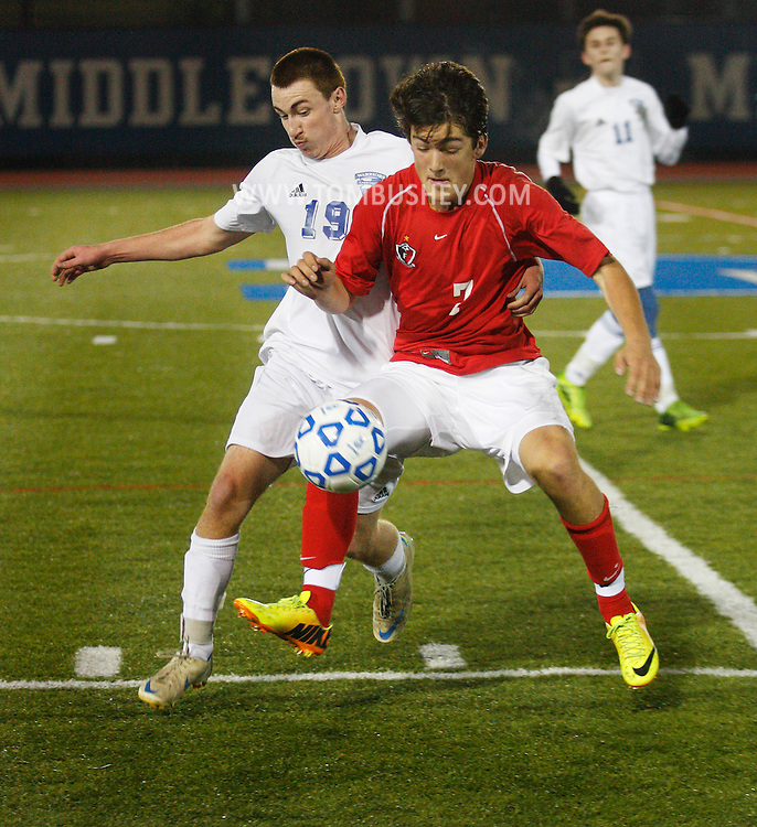 Craig Keenan (19) of Lake George battles Maximilian Heffron (7) of Friends Academy for the ball during a Class C state semifinal game at Faller Field in Middletown on Saturday, Nov. 16, 2013. (Tom Bushey – Special to The Post-Star)