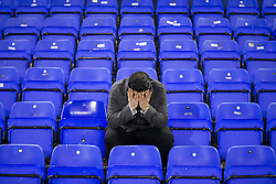 © Licensed to London News Pictures . FILE PICTURE DATED 23/01/2016 . Oldham , UK . An Oldham Athletic fan puts his head in his hands after their home defeat by Bury . Oldham Athletic vs Bury at Boundary Park . Oldham has been named England's most deprived town by the Office for National Statistics today (18th March 2016) . Photo credit : Joel Goodman/LNP
