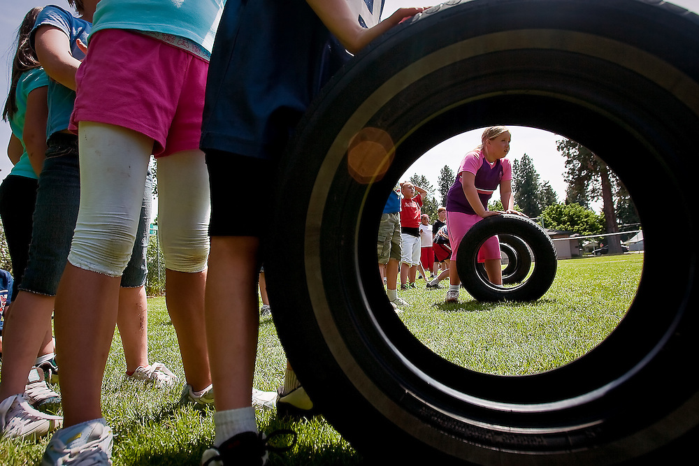JEROME A. POLLOS/Press..Baehley Lyght, 9, waits at the starting line for a tire race against others in her third grade class Tuesday during field-day activities at Bryan Elementary.
