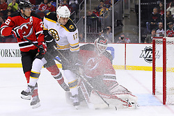 Jan 19; Newark, NJ, USA; New Jersey Devils goalie Martin Brodeur (30) makes a save on Boston Bruins left wing Milan Lucic (17) while New Jersey Devils center Patrik Elias (26) defends during the first period at the Prudential Center.