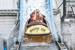 May 25, 2019 - Brighton, East Sussex, United Kingdom - Brighton, UK.  Members of the public take a ride on the Brighton Palace Pier Big Splash water attraction on the May Bank holiday Saturday. (Credit Image: © Hugo Michiels/London News Pictures via ZUMA Wire)