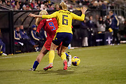 USA midfielder Lindsey Horan (9) and Sweden's Magdalena Eriksson (6) compete for the ball during an international friendly women's soccer match, Thursday, Nov. 7, 2019, in Columbus, Ohio. USA defeated Sweden 3-2 . (Jason Whitman/Image of Sport)