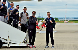 LIVERPOOL, ENGLAND - Sunday, June 2, 2019: Liverpool's manager Jürgen Klopp and captain Jordan Henderson arrive home at Liverpool John Lennon Airport with the trophy after winning the UEFA Champions League Final beating Tottenham Hotspur 2-0 to win their sixth European Cup. (Pic by David Rawcliffe/Propaganda)