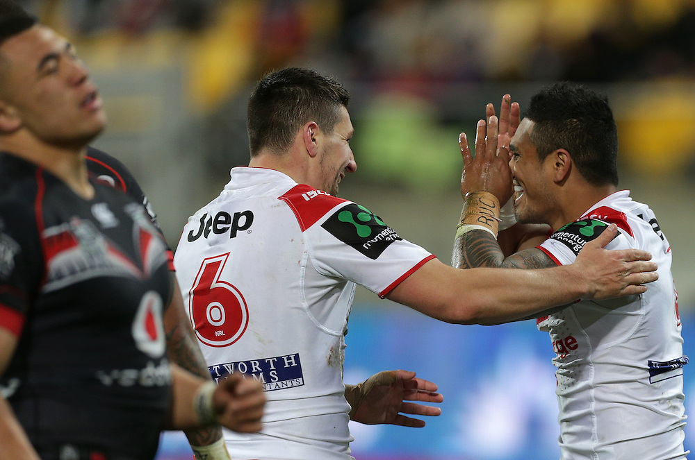 Gareth Widdop, left,  congratulates Peter Mata`utia of the Dragons for scoring a try against the Warriors during their round 22 NRL match at Westpac  Stadium, Wellington on  Saturday, August 08, 2015. Credit: SNPA / David Rowland