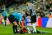 Isaac Hayden (#14) of Newcastle United and Fabian Schar (#5) of Newcastle United check on Anthony Martial (#11) of Manchester United after he is struck in the face by the ball during the Premier League match between Newcastle United and Manchester United at St. James's Park, Newcastle, England on 2 January 2019.