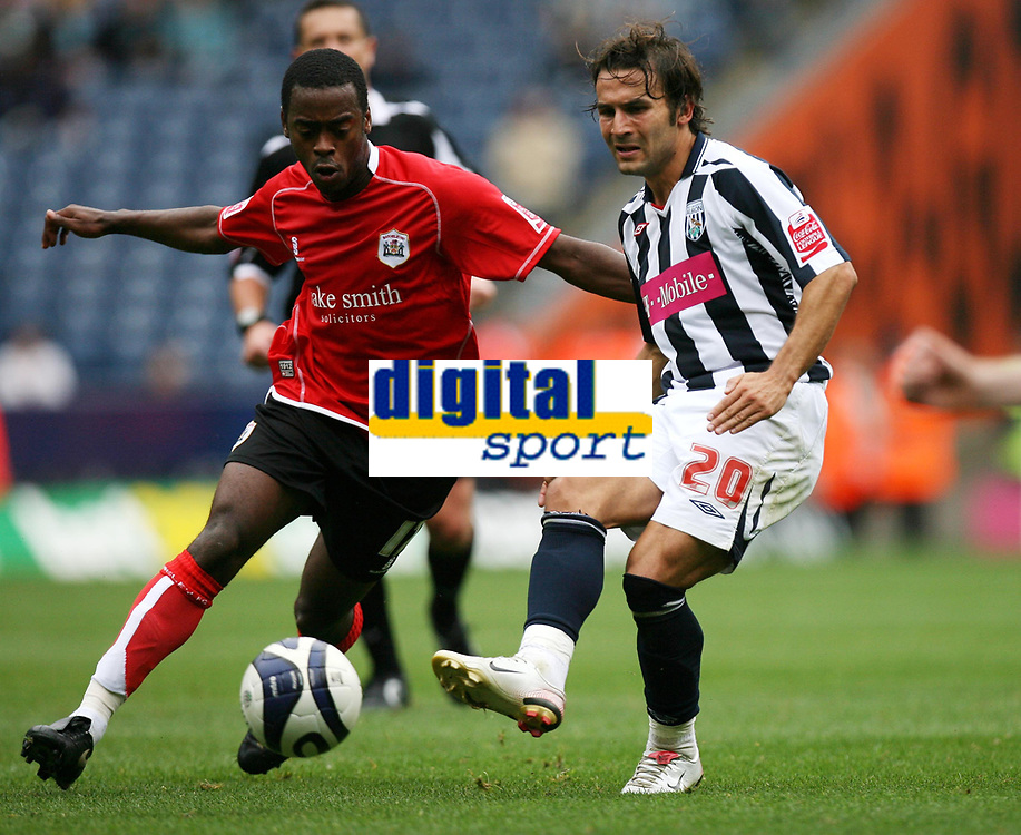 Photo: Rich Eaton.<br /> <br /> West Bromwich Albion v Barnsley. Coca Cola Championship. 01/09/2007. West Bromwich Albion's Filipe Teixeira (r) passes as Rohan Ricketts challenges.