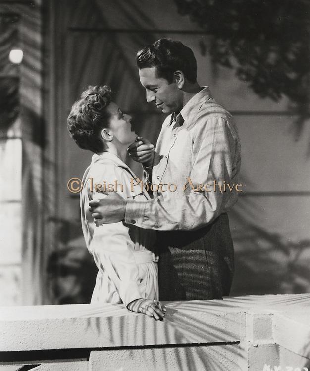NOW VOYAGER, Warner Bros., 1942. Producer: Hal. B. Wallis. Director: Irving Rapper. Bette Davis (1908-1989) and Paul Henreid.