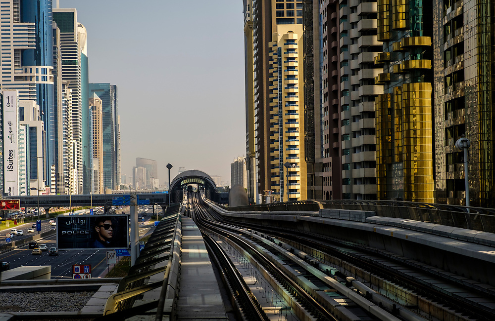UNITED ARAB EMIRATES, DUBAI - CIRCA JANUARY 2017: Dubai Metro over the Sheikh Zayed Road. This is the main artery of the city and is home for most of the Dubai skyscrapers.