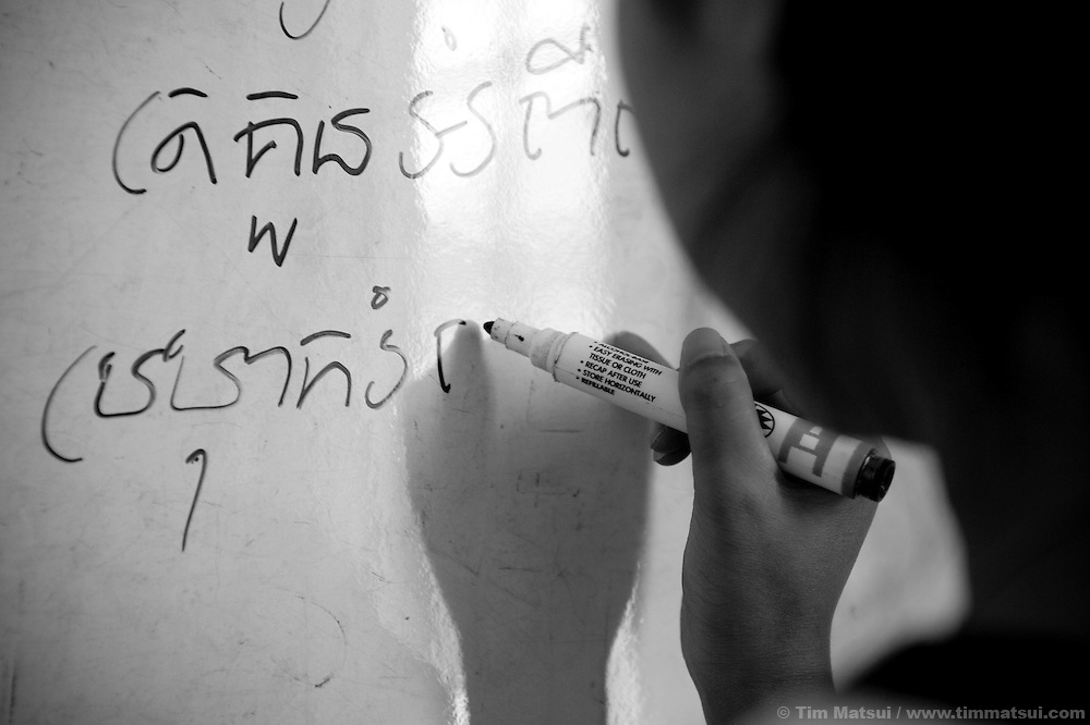 "A young woman works on her literacy at Tom Dy, a residential facility run by the non governmental organization ""Acting for Women in Distressing Situations"" (AFESIP) on the outskirts of Phnom Penh, Cambodia. Tom Dy offers housing, education, training, and counseling for women who are victims of sex trafficking, worked as prostitutes, or are escaping domestic violence. Founded by Somaly Mam, who herself was once a prostitute and victim of trafficking and domestic abuse, AFESIP has three facilities in Cambodia and works with other NGO's to provide long term care for the women...The classroom instructor (white sleeve) is Touch Samol."