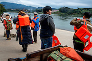 Passengers wait for a ferry boat in Xishuangbanna prefecture, China.