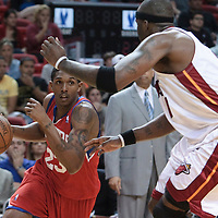 14 March 2010: Philadelphia 76ers guard Lou Williams drives past Miami Heat center Jermaine O'Neal during the Miami Heat 100-89 victory over the Philadelphia 76ers at the AmericanAirlines  Arena, in Miami, Florida, USA.