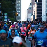 NYTRUN - NOV. 6, 2016 - NEW YORK - Runners head West on Central Park South as they participate in the 2016 TCS New York City Marathon on Sunday afteroon. NYTCREDIT:  Karsten Moran for The New York Times
