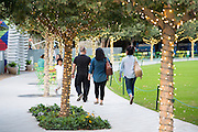 Visitors walk through Klyde Warren Park in Dallas, Texas on November 17, 2016. (Cooper Neill for The New York Times)