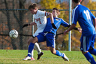 Mt. Anthony's Carter Bentley (9) battles for the ball with CVU's Brock Warner (4) during the boys semifinal soccer game between Mount Anthony and Champlain Valley Union at CVU high school on Tuesday afternoon October 27, 2015 in Hinesburg. (BRIAN JENKINS/ for the FREE PRESS)