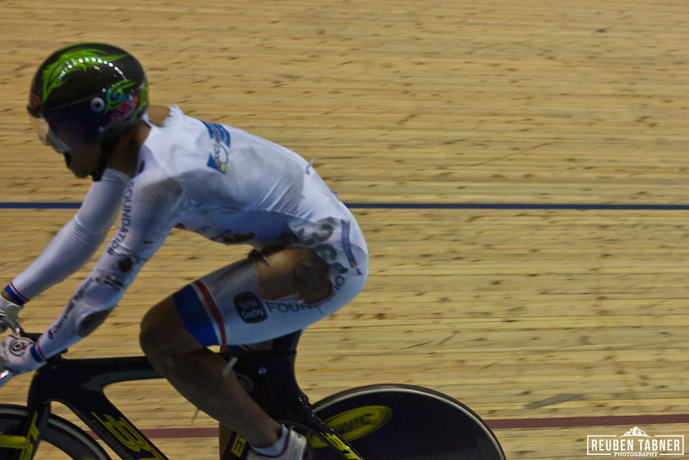 Azizulhasni Awang crosses the line in the men's Keirin final to take the Bronze Medal, despite having a splinter from the track right through his leg. ..A major crash on the final bend of the Men's Keirin, Final left a number of injuries. The worst appeared to be a splinter which penetrated right through the leg of the Malaysian rider Azizulhasni Awang.