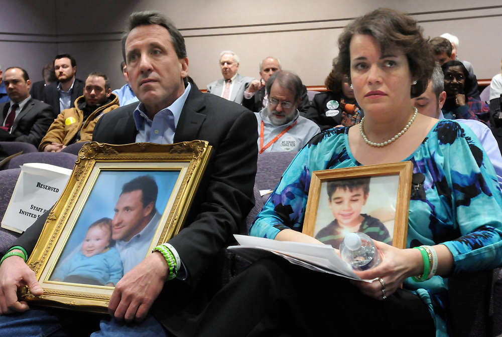 Legislative Office Building, Hartford, CT state legislature's Gun Violence Prevention Task Force hearing. Neil Heslin of Shelton, left, and Veronique Pozner of Newtown, parents of children killed in Sandy Hook (Jesse Lewis left, Noah Pozner right) listen to gun manufacturers testify. Mara Lavitt/New Haven Register<br /> <br /> 1/27/13
