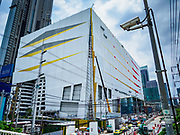 17 SEPTEMBER 2018 - BANGKOK, THAILAND:  The ICONSIAM construction site as seen from a pedestrian overpass on Chareon Nakhon Road. ICONSIAM is a mixed-use development on the Thonburi side of the Chao Phraya River. It is expected to open in 2018 and will include two large malls, with more than 520,000 square meters of retail space, an amusement park, two residential towers and a riverside park. It is the first large scale high end development on the Thonburi side of the river and will feature the first Apple Store in Thailand and the first Takashimaya department store in Thailand.   PHOTO BY JACK KURTZ