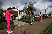 Girls jump rope across the street from a domestic assault in Los Angeles, Calif. on Jan. 30, 2011. (photo by Gabriel Romero ©2011)