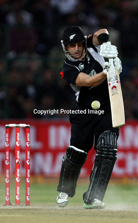 New Zealand batsman Nathan McCullum plays a shot during the 2nd ODI india vs New Zealand Played at Sawai Mansingh Stadium, Jaipur, 1 December 2010 - day/night (50-over match)
