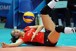 Belgium Charlotte Leys digs a ball