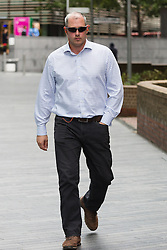© Licensed to London News Pictures. 30/07/2015. London, UK. Biker, MICHAEL BOURNE leaves Southwark Crown court today. Bourne allegedly hit retired judge Sir Anthony May QC when speeding on a Suzuki motorbike in central London. Sir Anthony, aged 74 suffered serious injuries. Photo credit : Vickie Flores/LNP
