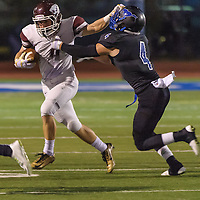 Clear Creek #9 Austin Mathews tries to hold off Friendswood #4 Blake King during the game at Winston Stadium in Friendswood 10/17/14