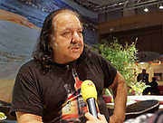 Berlin, Germany - 18 October 2012<br /> Porn star Ron Jeremy promoting his 'Ron Jeremy' brand of rum at the Venus Berlin 2012 adult industry exhibition in Berlin, Germany. Ron Jeremy, born Ronald Jeremy Hyatt, has been an American pornographic actor since 1979. He faces sexual assault allegations which he strenuously denies. There is no suggestion that any of the people in these pictures have made any such allegations.<br /> www.newspics.com/#!/contact<br /> (photo by: EQUINOXFEATURES.COM)<br /> Picture Data:<br /> Photographer: Equinox Features<br /> Copyright: &copy;2012 Equinox Licensing Ltd. +448700 780000<br /> Contact: Equinox Features<br /> Date Taken: 20121018<br /> Time Taken: 12151798
