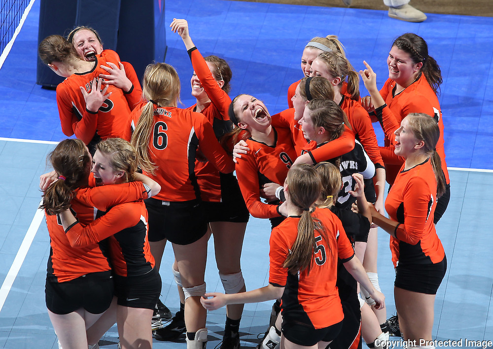 West Delaware celebrates following the fifth game of a 3A semifinal in the state volleyball tournament at the U.S. Cellular Center at 370 1st Ave E on Friday afternoon, November 12, 2010. (Stephen Mally/Freelance)