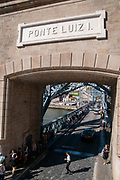 Street and entrance gate to lower deck of Ponte Luiz I (Luis I) Bridge in Porto, Portugal