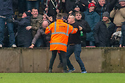 Rotherham United fan invades the pitch after Rotherham United Defender Semi Ajayi (5) scored during the EFL Sky Bet League 1 match between Scunthorpe United and Rotherham United at Glanford Park, Scunthorpe, England on 10 February 2018. Picture by Craig Zadoroznyj.
