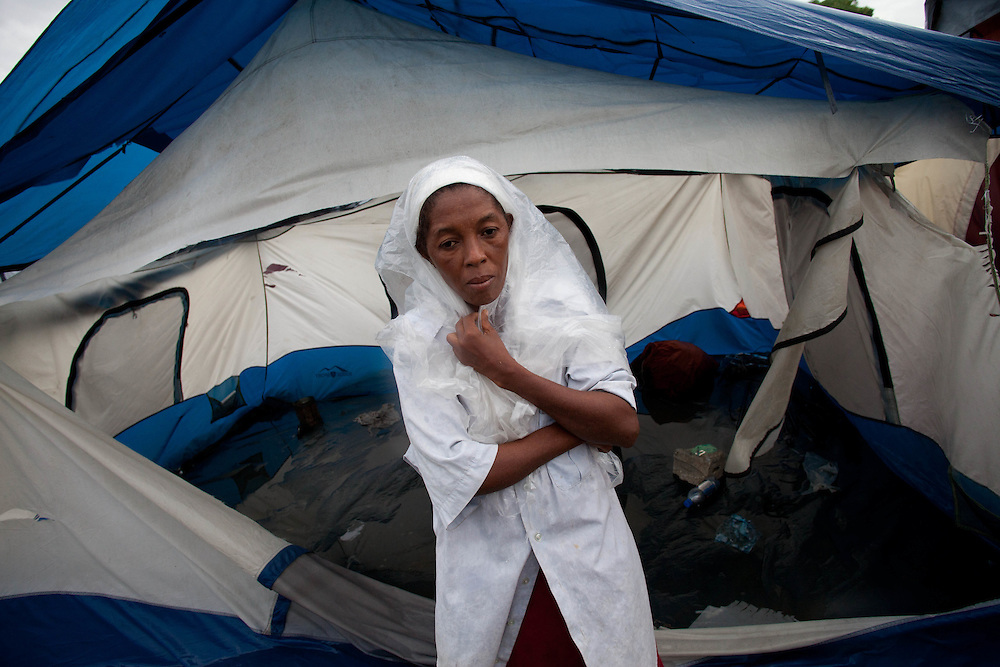 Eveline Mosa stands in front of her flooded and torn tent damaged in wind from hurricane Tomas early this morning.