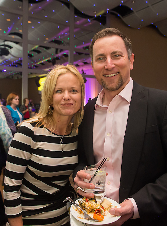 DENVER, CO - APRIL 7: Christine Moser (L) and Reid Wycoff (R) pose for a photo during the Denver Post Top Workplaces event at the Seawell Grand Ballroom at the Denver Center for Performing Arts on April 7, 2015, in Denver, Colorado. (Photo by Daniel Petty/The Denver Post)