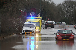 © Licensed to London News Pictures. 24/12/2013<br /> An ambulance on route to a 999 call heads into flood water at Polhill in Kent with help from men in a white jeep in front.<br /> London Road A224  Polhill in Halstead, Kent is closed with cars abandoned in 4 feet of rain water overnight.<br /> The UK  has woken up to trees and electricity cables down following a night of gale-force winds and torrential rain.<br /> Photo credit :Grant Falvey/LNP