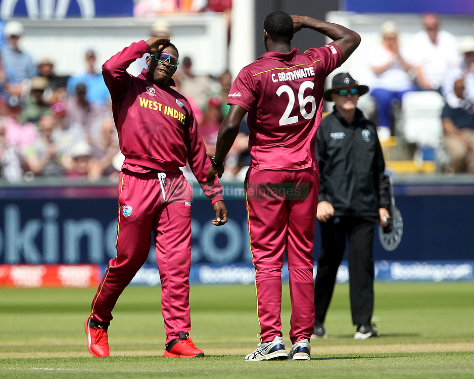 July 1, 2019 - Chester Le Street, County Durham, United Kingdom - West Indies' Sheldon Cottrell and Carlos Brathwaite salute each other after running out Sri Lanka's Kusal Perera during the ICC Cricket World Cup 2019 match between Sri Lanka and West Indies at Emirates Riverside, Chester le Street on Monday 1st July 2019. (Credit Image: © Mi News/NurPhoto via ZUMA Press)
