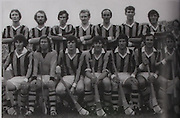 "Kilkenny All-Ireland Hurling Champions 1975. Back Row: Brian Coady, Tom McCormack, Mick Crotty, Pat Henderson, Eddie Keher, Frank Cummins, Pat Delaney, Fan Larkin. Front Row: Liam ""Chunky"" O'Brien, Noel Skehan, Billy Fitzpatrick (capt), Mick Brennan, Pat Lalor, Kieran Purcell, Nicky Orr."