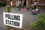 Mothers and their children exit Herne Hill Baptist Church, Herne Hill SE24 that serves as a temporary Polling station for voters on Britain's general election day.