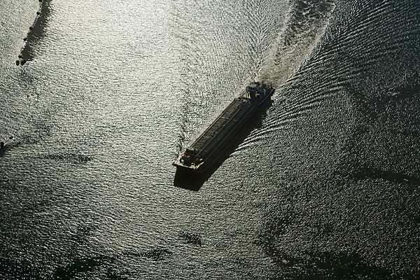 Aerial view of a barge passing through the Port of Houston