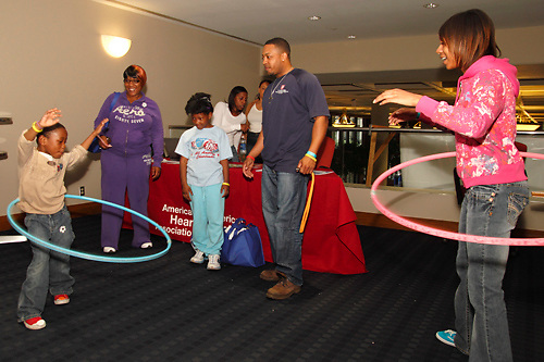 Shun Bonds, 5 of Huber Heights (left) joins Jaya Hardy, 16 of Dayton in a little hula hoop action during the 10th Annual Celebrating life & health free community health fair at Sinclair's Ponitz Center in downtown Dayton, Saturday, April 21, 2012. Hardy says by using the hula hoop at the health fair she's 'encouraging everyone to get active.'  More than 50 vendors were spread over three floors providing vision, hearing, blood pressure and other screenings, health information and entertainment.