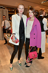 Left to right, CANDICE LAKE and ELLA CATLIFF at the Roger Vivier 'The Perfect Pair' Frieze cocktail party celebrating Ambra Medda & 'Miss Viv' at the Roger Vivier Boutique, Sloane Street, London on 15th October 2014.