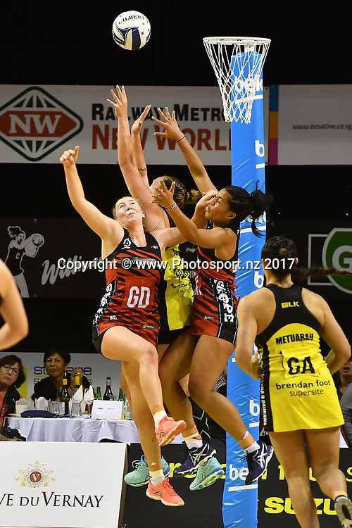 Tactix's Zoe Walker Top R) with team mate Temalisi Fakahokotau (L) jump for the ball with Pulse's Te Amo Amaru-Tribble (C during the ANZ Premiership netball match between the Wellington Pulse vs Mainland Tactix at TSB Arena in Wellington on Sunday the 9th of April 2017. Copyright Photo by Marty Melville / www.Photosport.nz