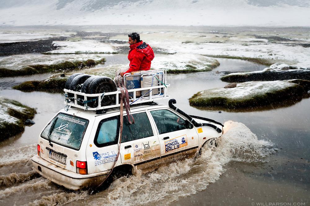 The Spanish Mongol Rally team Objetivo Ulansafor crosses a frigid stream with their 2000 Kia Pride Wagon in Bayan-Ölgii Province, Mongolia, Aug. 15, 2009. The team started in Spain and had driven through Turkey, Iran, Turkmenistan, Tajikistan, Kyrgyzstan, Kazakhstan and Russia.