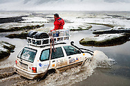 The Spanish Mongol Rally team Objetivo Ulansafor crosses a frigid stream with their 2000 Kia Pride Wagon in Bayan-Ölgii Province, Mongolia, Aug. 15, 2009. The team started in Spain and had driven through Turkey, Iran, Turkmenistan, Tajikistan, Kyrgyzstan, Kazakhstan and Russia.