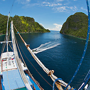 Wide angle picture around the islands of Misool from the lookout of a sailing boat.