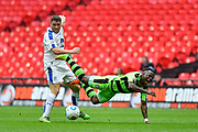 Tranmere Rovers Adam Buxton(22) fouls Forest Green Rovers Drissa Traoré(4) during the Vanarama National League Play Off Final match between Tranmere Rovers and Forest Green Rovers at Wembley Stadium, London, England on 14 May 2017. Photo by Adam Rivers.