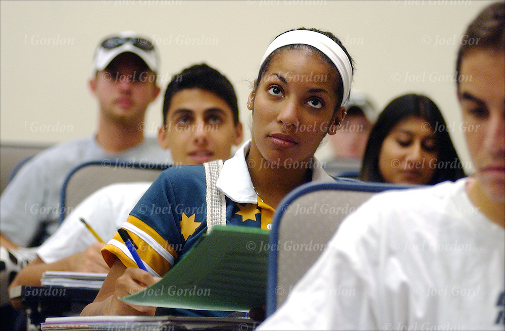 UCF students on college classroom on campus, listening to professor and taking notes