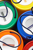 Colorful plastic money boxes view from above