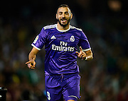 SEVILLE, SPAIN - OCTOBER 15:  Karim Benzema of Real Madrid CF celebrates after scoring during the match between Real Betis Balompie and Real Madrid CF as part of La Liga at Benito Villamrin stadium October 15, 2016 in Seville, Spain.  (Photo by Aitor Alcalde/Getty Images)
