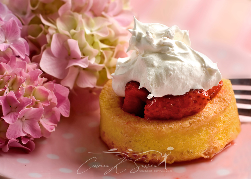 A dessert cup, filled with strawberries and sugared syrup, topped with whipped cream, makes a fast, easy strawberry shortcake to throw together for company or as a one-serving treat. (Photo by Carmen K. Sisson/Cloudybright)