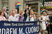 New York Governor Andrew Cuomo, in the blue blazer, in the lead section of the 2011 Pride Parade on New York's Fifth Avenue. Cuomo was instrumental in legalizing gay marriage less that 2 days prior to the start of the parade. Also behind the banner, waving the rainbow flag, is Andrew's father, former governor Mario Cuomo.